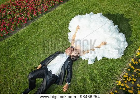 Married Couple Posing On Grass