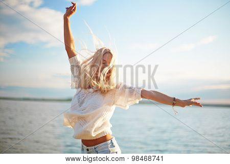 Delighted blond girl enjoying summer rest