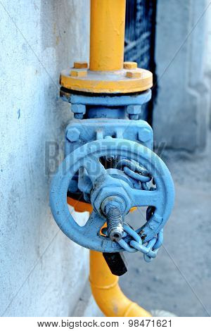 Blue valve of yellow natural gas pipe