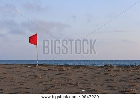 Red Flag On Beach