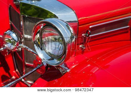 Detail on the headlight of a vintage car