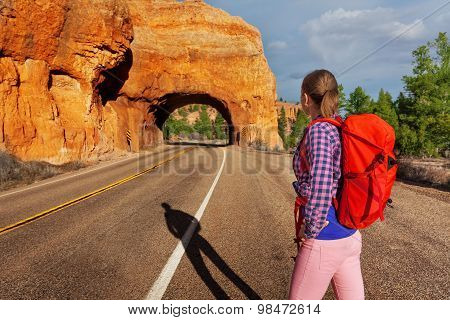 Close-up of girl with rucksack near Red canyon
