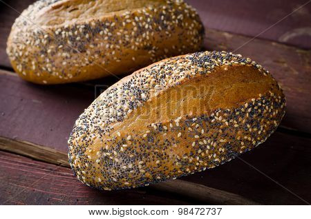 Freshly baked small breads with sesame and poppy seeds
