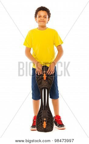 African boy standing holding skate board