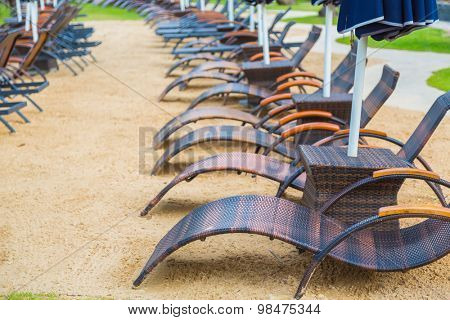 Beach chairs and umbrella on sand beach