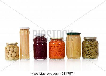 Variety Of Canned Vegetables In Jars.