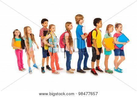 Many happy kids in a line to school