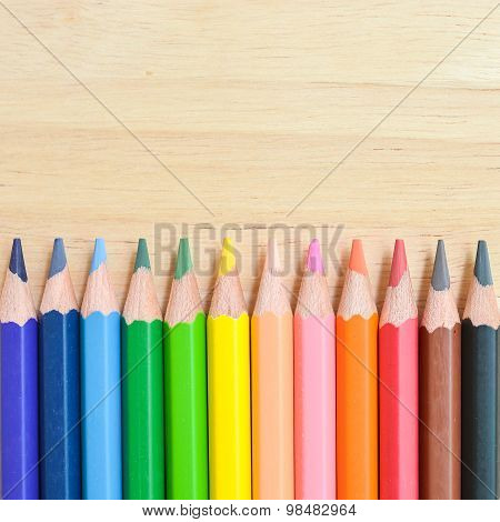 Color Pencils On Wooden Table