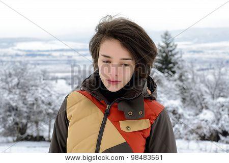 Beautiful woman standing outside in winter.