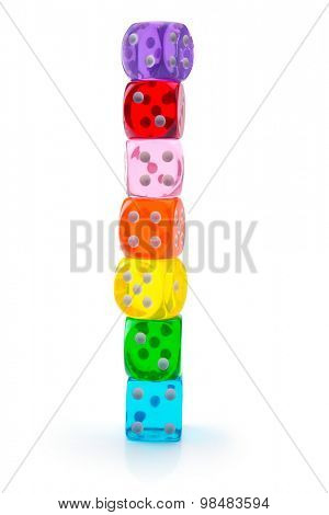 dice in seven different colors stacked up, isolated on white. Seven transparent acrylic dice in rainbow colors stacked.