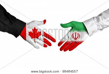 Canadian and Iranian leaders shaking hands on a deal agreement