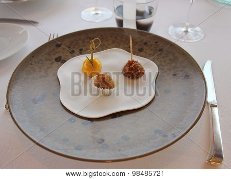 Dessert, three separated bon-bons in the restaurant