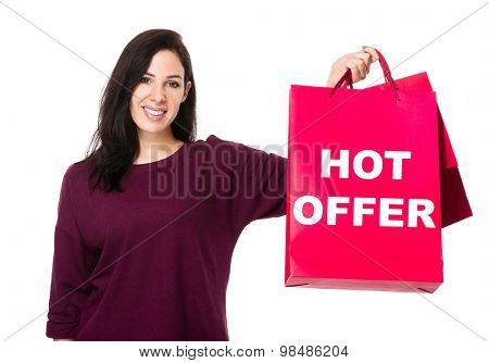 Caucasian woman show with shopping bag and showing hot offer