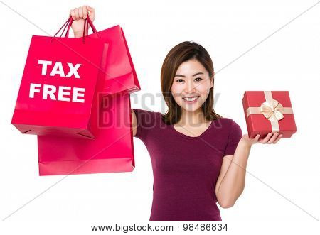 Woman hold with shopping bag and giftbox showing tax free