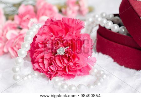 Engagement Diamond Ring In Pink Carnation Flower With Pearl Neklace