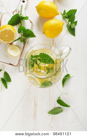 Cold Water With Fresh Lemon And Mint In A Glass Jug.