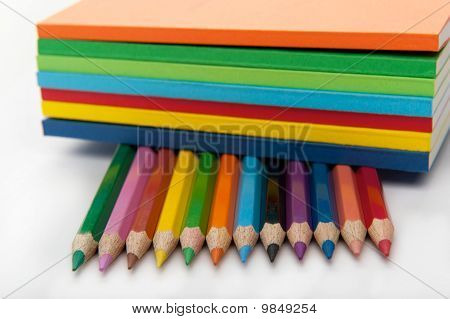 row of the pencils under the stack of books