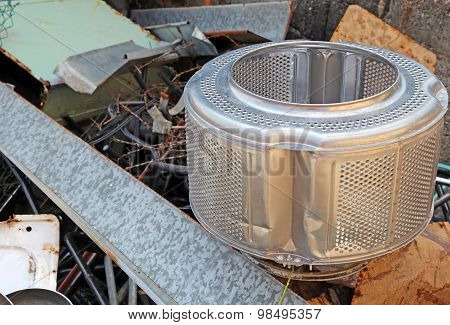 Washing Machine Basket And Rusty Pieces Of Iron In The Landfill