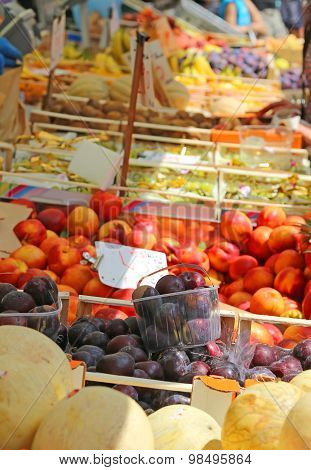 Fruit And Vegetable Stand With Basket Full Of Seasonal Fruits