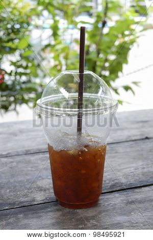 Delicious Ice Coffee Americano With Coffee Glass Lid And Straws On Wood Table.