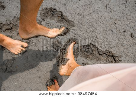 Couple's feet in the mud