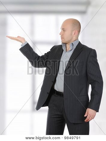 Businessman In A Suit Holds Her Hand