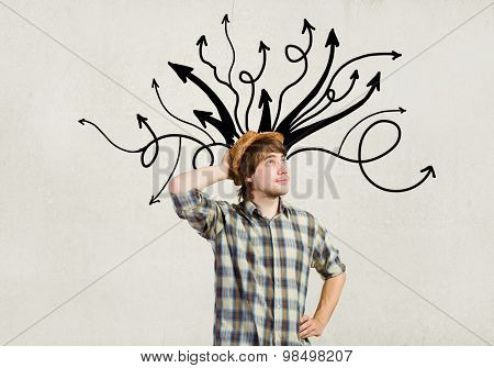 Young pensive man and thoughts coming out of his head