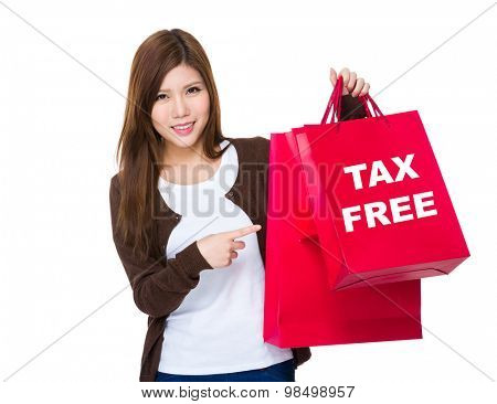 Young woman finger point to shopping bag tax free