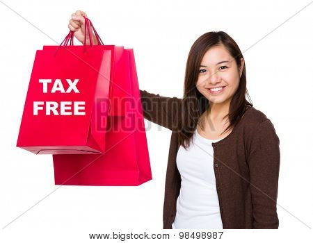Asian woman holding with shopping bag and showing tax free
