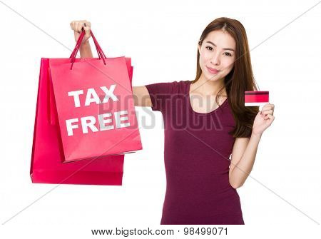Woman hold shopping bag and credit card with showing tax free