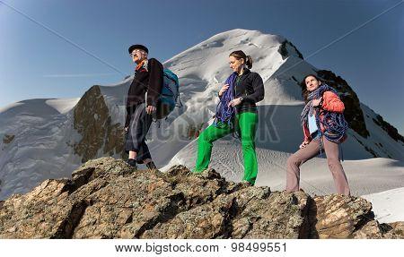 Three people family hike mountain