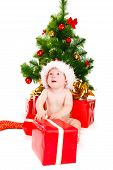 stock photo of christmas baby  - Astonished baby in Christmas hat - JPG