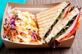 stock photo of food truck  - grilled turkey and cheese panini with home made cole slaw truck food style - JPG