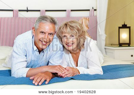 Happy mature couple at home.