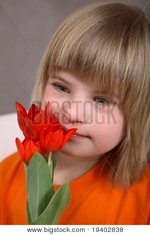 A pretty blond 9-year old girl with Downs Syndrome