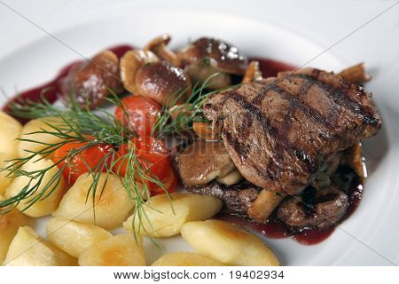 grilled beef and vegetables on a plate