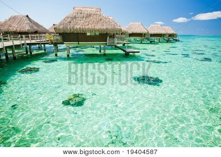 Over water bungalow with steps into amazing green lagoon
