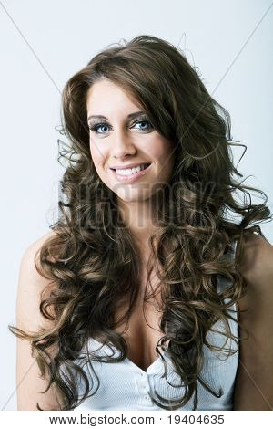 Portrait of beautiful woman with blue eyes and long curly hair