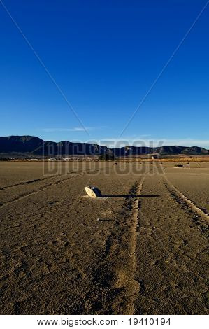 Dry salt lake - desert landscape, trace of tires detail - global warming, climate change