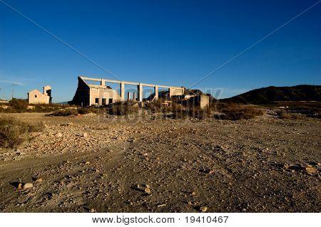 Abandoned factory - rural spanish scenery, dry soil