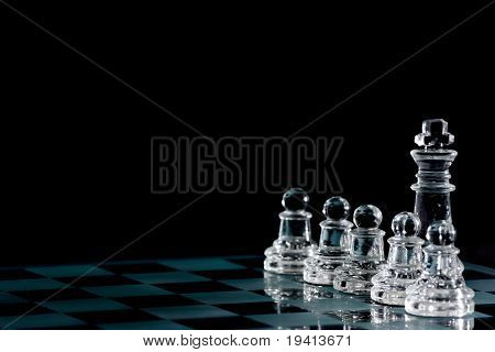 Strategic games; chess; king and five pawns on chess board