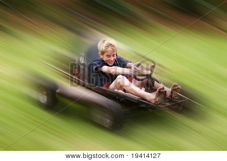 Young teenager having fun in a go-cart at high speed