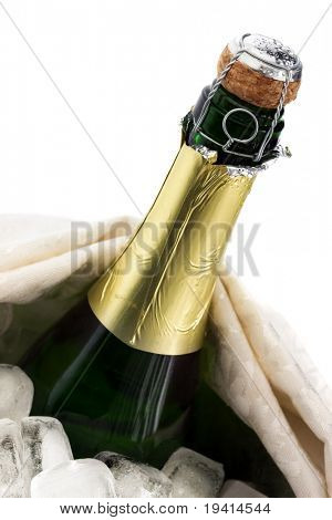 Close-up of a cold bottle of champagne on ice with white background