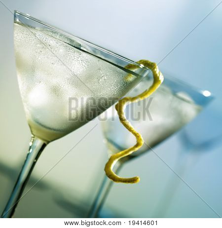 Martini with lemon peel and condensation on glass (focus on front glass)