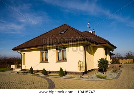 Single family small house over blue sky