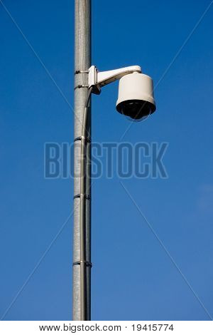 Surveillance security camera located over a street