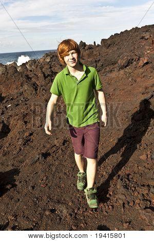 Boy Walking In Volcanic Area