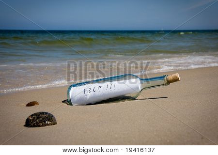 Help message in the bottle on a sea shore