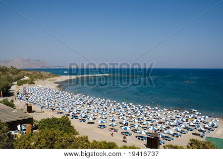 A sunny beach with lots of parasols, Rhodes, Greece