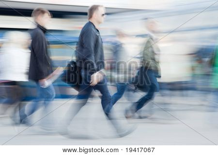 Blurred image of business people rushing to work in the morning
